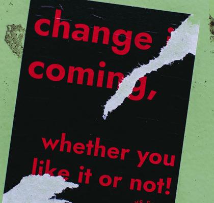 Plakat mit Schriftzug change coming